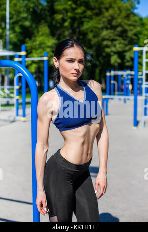 strong athletic female on sport playground - Stock Photo