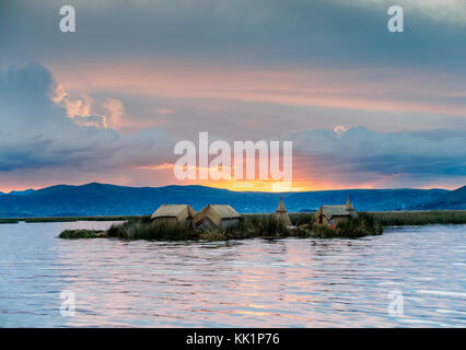 Uros Floating Islands at sunset, Lake Titicaca, Puno Region, Peru - Stock Photo