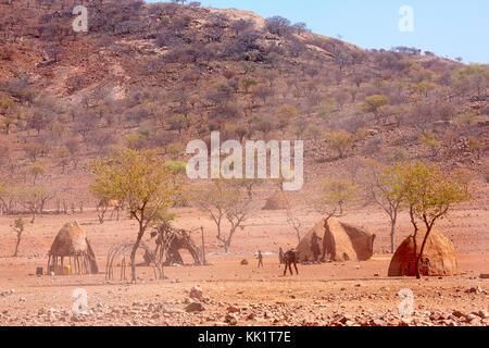Traditional himba village near Epupa Falls, Kaokoveld, Namibia, Africa - Stock Photo
