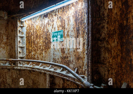 Rusting staircase wall panel in disused underground King William Street Station, northern terminus of City and South - Stock Photo