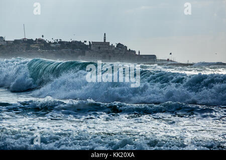Large waves in front of Israel Old Jaffa as seen from northern Tel Aviv beach. - Stock Photo