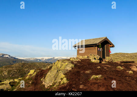 Survival cabin in the mountain near Trolltunga in Odda, Norway - Stock Photo