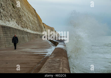 Waves breaking against sea defences on the East Sussex coast, England. - Stock Photo