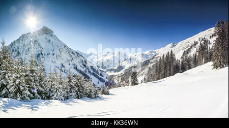 Mountains winter landscape with deep snow on clear sunny day. Allgau, Bavaria, Germany. - Stock Photo