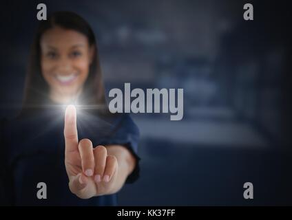 Digital composite of Businesswoman touching air glow - Stock Photo