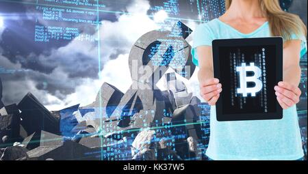 Digital composite of Bitcoin icon on tablet in woman's hands with broken dollar stone - Stock Photo