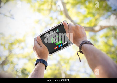 Mobile display with memory cleaner against cropped hands using digital tablet - Stock Photo