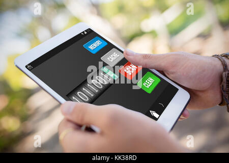 Mobile display with memory cleaner against close-up of man hands using digital tablet - Stock Photo
