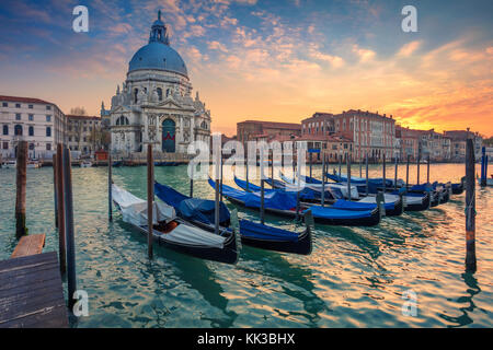 Venice. Cityscape image of Grand Canal in Venice, with Santa Maria della Salute Basilica in the background. - Stock Photo
