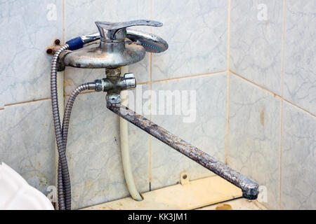 Old faucet in the bathroom - Stock Photo