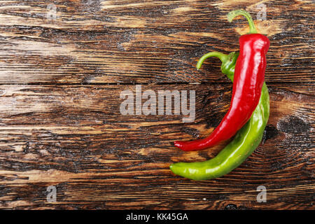 green and red  pepper on wooden surface. Horizontal photo with free space area for text or design. - Stock Photo