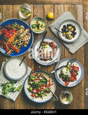 Flat-lay of healthy dinner table setting with snacks - Stock Photo