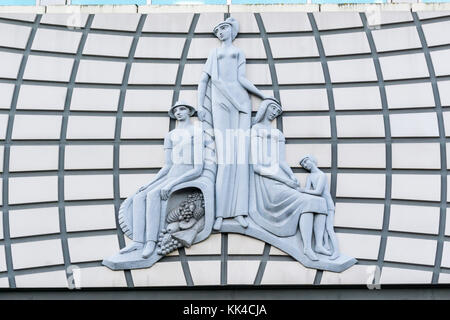 Relief over entrance to 1960s Amp House in Croydon. - Stock Photo