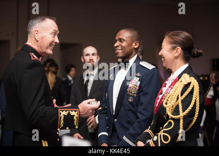 U.S. Marine Corps Gen. Joseph F. Dunford, Jr., chairman of the Joint Chiefs of Staff, speaks with U.S. Air Force - Stock Photo
