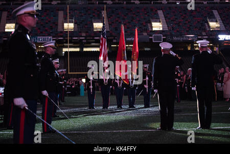 Members of a Marine Forces Reserve Color Guard present the colors at the Mercedes-Benz Superdome, New Orleans, Louisiana, - Stock Photo