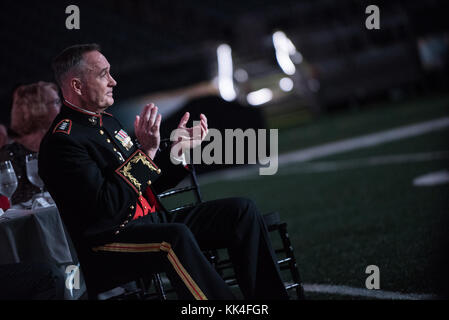 U.S. Marine Corps Gen. Joseph F. Dunford, Jr., chairman of the Joint Chiefs of Staff, applauds during the U.S. Marine - Stock Photo