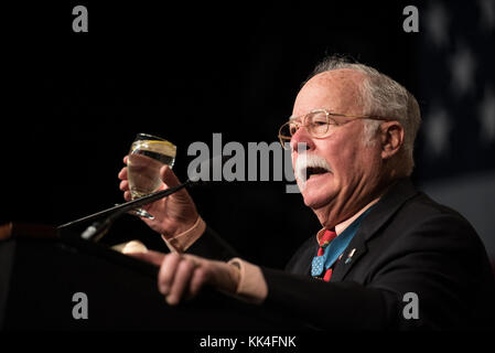Retired U.S. Marine Corps. Col. Harvey C ÔBarneyÕ Barnum, a Vietnam war Medal of Honor Recipient, toasts during - Stock Photo