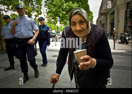 Urban Poverty -  13/06/2012  -    -  The blue-gypsy, - The blues (cops) and the gypsy,  - Identity check of the - Stock Photo