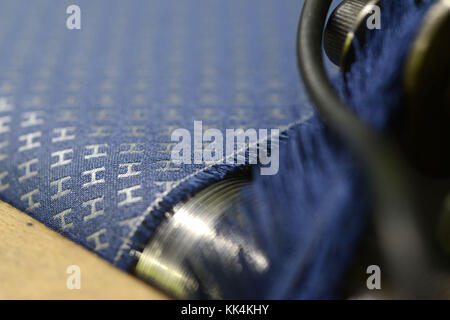 Bussieres (central-eastern France): fabric that will be used to make Hermes ties in the premises of the weaving - Stock Photo