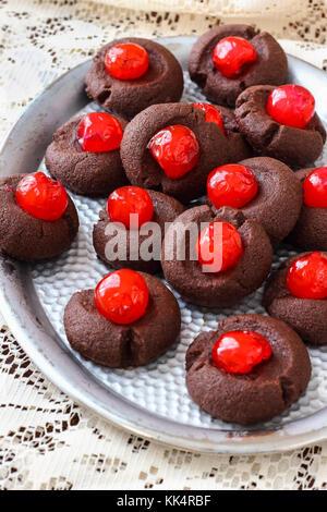 Chocolate Thumbprint Cookies with Maraschino Cherries - Stock Photo
