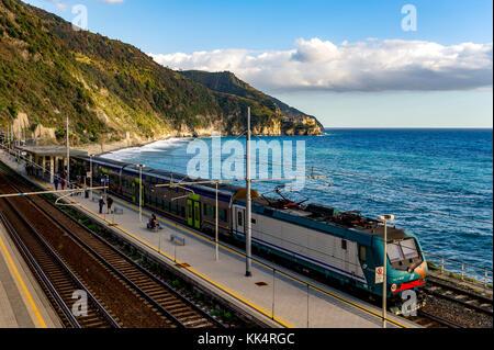 Italy. Liguria. Cinque Terre National Park UNESCO World Heritage Site.  Train in Corniglia Station - Stock Photo