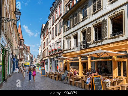 Cafes and shops in the historic old town, Strasbourg, Alsace, France - Stock Photo