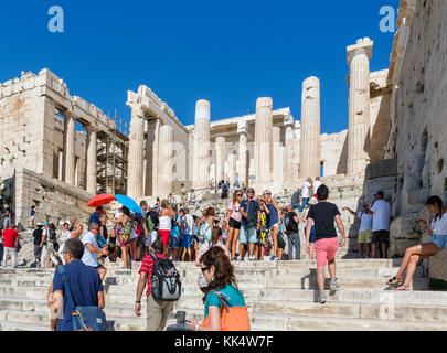 Crowds of tourists on the steps leading up to the Propylaea, Acropolis, Athens, Greece - Stock Photo