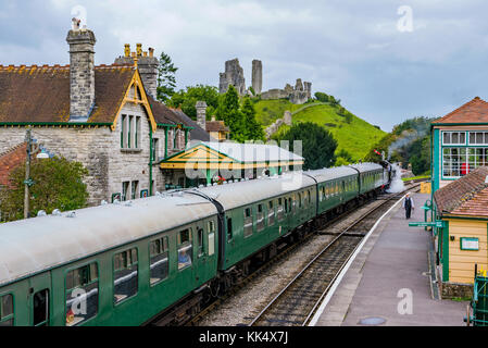 CORFE, UNITED KINGDOM - SEPTEMBER 06: This is a view of Corfe Castle railway station with an old steam train passing - Stock Photo