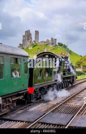 CORFE, UNITED KINGDOM - SEPTEMBER 06: This is a traditional British steam train passing through the medieval town - Stock Photo