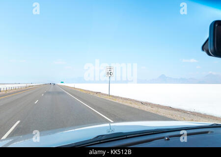 Highway Speed Limit 80 mph sign on the I-80 West through Bonneville Salt Flats near Wendover Utah. - Stock Photo