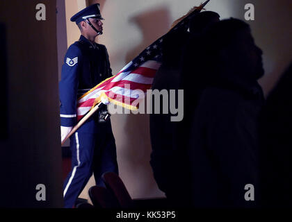 A member of the Joint Base San Antonio Honor Guard prepares to post the colors during a military funeral service - Stock Photo