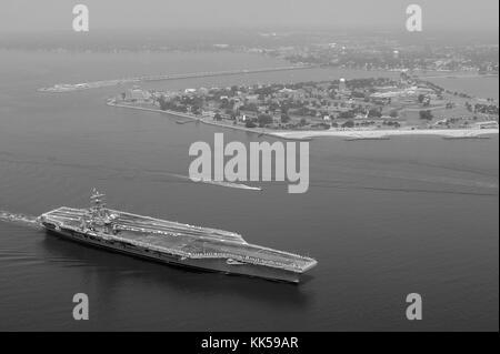 Nimitz-class aircraft carrier USS Dwight D Eisenhower CVN 69 transits over the Hamptons Roads Bridge Tunnel as it - Stock Photo