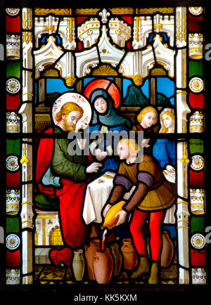 Faversham, Kent, England. St Mary of Charity parish church. Stained glass window: Wedding at Cana - turning water - Stock Photo