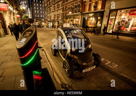 London Covent Garden area, England, UK. Electric car being charged up. Nov 2017 - Stock Photo