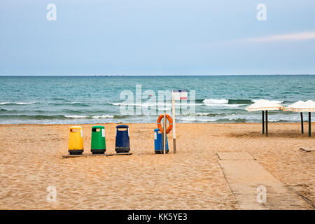 colorful recycle bins in the beach to recycle garbage - Stock Photo