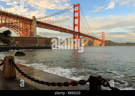 Golden Gate Bridge and chain link Fence. - Stock Photo