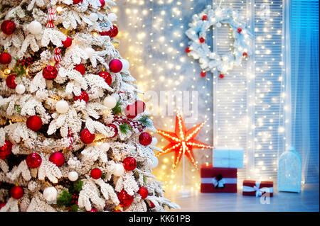 Christmas room interior. Christmas tree decorated with balls and bows, with gifts - Stock Photo