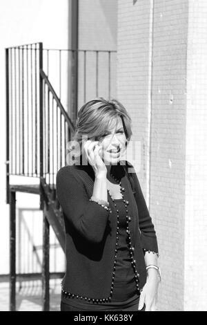 NATASHA KAPLINSKI NEWS READER  IN CENTRAL LONDON . BLACK AND WHITE IMAGE STOCK PHOTO. - Stock Photo