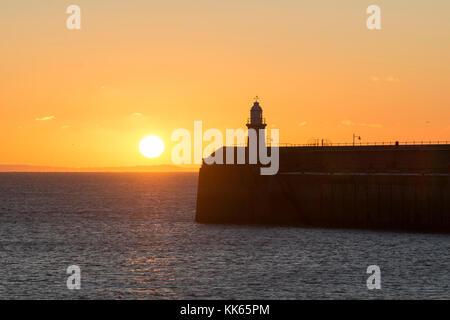 Lighthouse on the Folkestone Harbour Arm at sunrise, Kent - Stock Photo