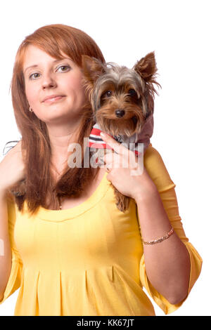Redhead Woman holding yorkshire terrier isolated on white - Stock Photo