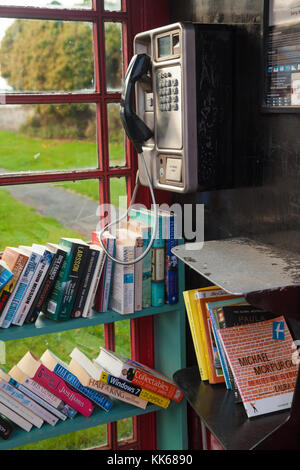 A new use for a British public telephone box, a library, in Athelstaneford East Lothian Scotland. - Stock Photo