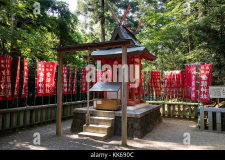 Nara - Japan, May 29, 2017: Shinto shrine in the the Kasugayama Primeval Forest, registered as a UNESCO World Heritage - Stock Photo