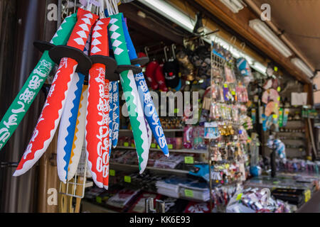 Strolling through the tourist shops of the slopes of Sannenzaka and Ninenzaka in Kyoto, Japan, before arriving at - Stock Photo
