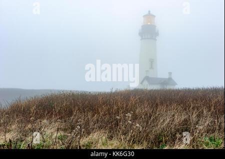 Yaquina Head Light, lighthouse on Oregon coast on a foggy day, Newport, Oregon, OR, USA.