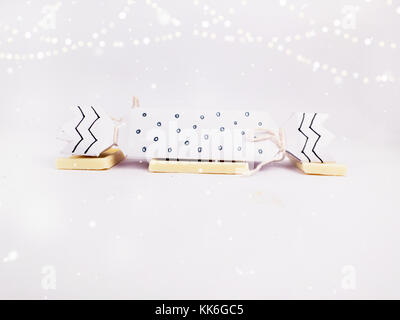 Christmas Decoration with black and white cracker chocolate box with golden bokeh and snow for holidays best background - Stock Photo