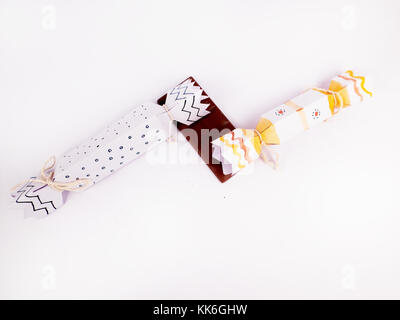 Flat Lay Christmas Decoration with cracker chocolate box and dark chocolate bar for holidays best background image - Stock Photo