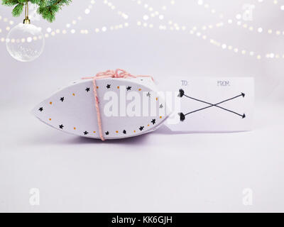 Christmas Decoration with White Square Round Christmas Gift Box with Christmas Ball and golden bokeh for holidays - Stock Photo