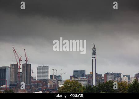 The view of Birmingham from along the Aston Expressway as dark clouds gather before a storm - Stock Photo