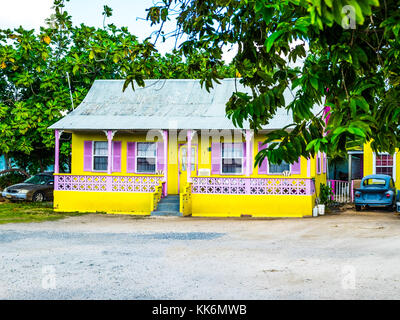 George Town, Grand Cayman, Cayman Islands, colorful Caribbean-style house with a tin roof and a veranda - Stock Photo