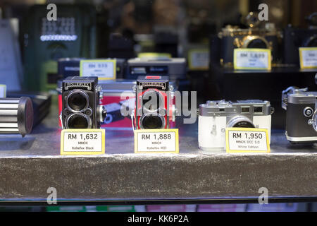 Old cameras on display - Stock Photo